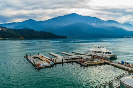 Beautiful Landscape of Sun Moon Lake in the morning with blue mountain background at Nantou, Taiwan