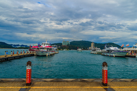 Nantou, Taiwan - November 21, 2015: Tourist likes to visit the beautiful attractions around the sun moon lake by boat cruise from Shuishe Pier to Ita Thao Pier, and then to Xuanguang Temple Pier Editorial