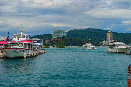 Nantou, Taiwan - November 21, 2015: Tourist likes to visit the beautiful attractions around the sun moon lake by boat cruise from Shuishe Pier to Ita Thao Pier, and then to Xuanguang Temple Pier 新聞圖片