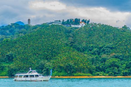 wharf: Beautiful Landscape of Sun Moon Lake in the morning with blue mountain background at Sun Moon Lake in Yuchi Township, Nantou County, Taiwan