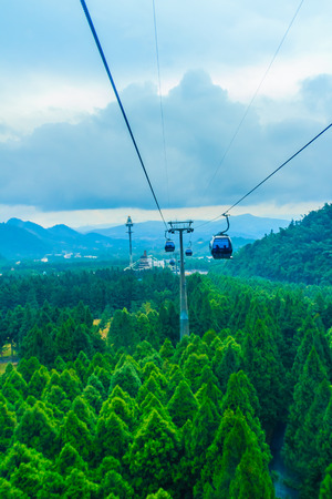 isles: The Sun Moon Lake Ropeway is a scenic gondola cable car service that connects Sun Moon Lake with the Formosa Aboriginal Culture Village theme park. Stock Photo