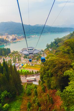 formosa: Nantou, Taiwan - November 21, 2015: The Sun Moon Lake Ropeway is a scenic gondola cable car service that connects Sun Moon Lake with the Formosa Aboriginal Culture Village theme park.