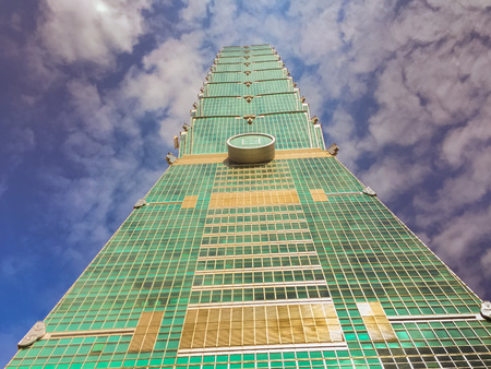 Taipei, Taiwan - November 22, 2015: Taipei 101 tower, view from the front of the tower, looking up.