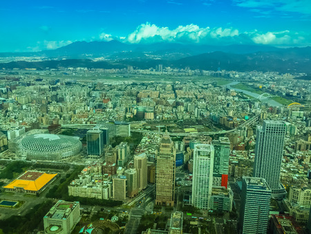 Aerial panorama over Taipei, capital City of Taiwan, on a blue sky and cloudy day
