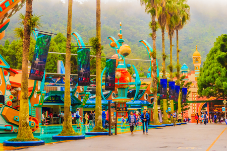 """Nantou, Taiwan - November 21, 2015: Joy to the World in Formosan Aboriginal Culture Village has the latest water roller coaster """"Caribbean Adventure"""", Taiwan's tallest """"UFO Freefall"""", and a wide range of indoor rides like """"Aladdin Square"""" wh"""