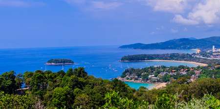 Beautiful panorama landscape view of turquoise ocean waves with boats, coastline and blue sky background from high aerial view point of Kata and Karon beaches in Phuket Thailand. Stock Photo