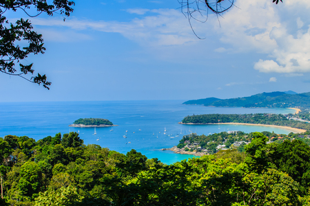 Beautiful landscape of turquoise ocean waves with boats, coastline and blue sky background from high aerial view point of Kata and Karon beaches in Phuket Thailand.