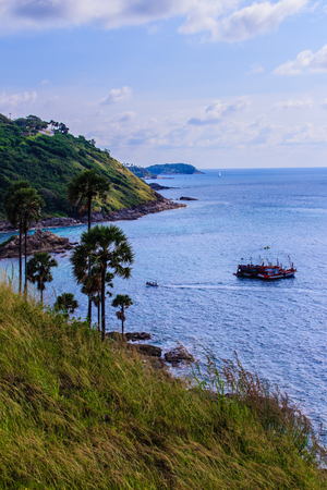 cruising: Colorful marine landscape with fisherman boat against deep blue sea under blue sky in the ocean on the cloudy day at Phuket, Thailand.