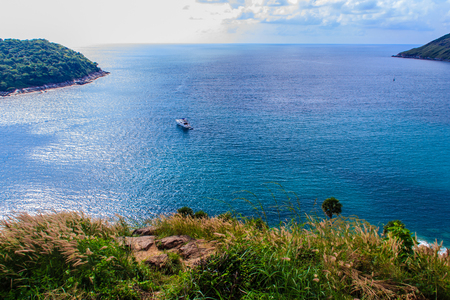 Beautiful seascape view of phuket cliff and small islands nearby Promthep cape, the most beautiful sunset viewpoint in Phuket, Thailand. Stock Photo