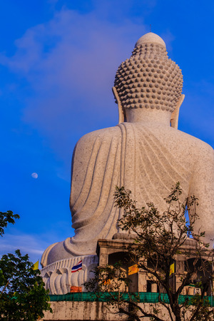 Amazing Massive white marble Buddha statue, the famous tourist attraction on top of hill in Phuket, Thailand. Stock Photo