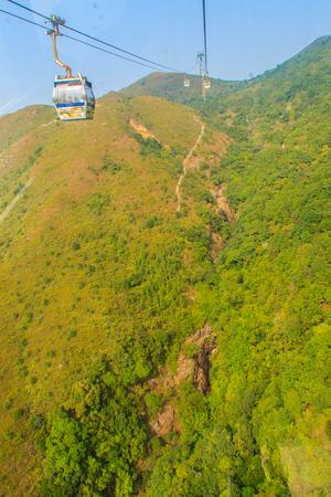Lantau Island, Hong Kong - November 14, 2014: Beautiful view from Hong Kong cable cars, the popular public transportation from Tung Chung Station to Ngong Ping village, Lantau Island, Hong Kong.