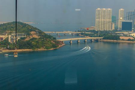 14: Lantau Island, Hong Kong - November 14, 2014: Beautiful view from Hong Kong cable cars, the popular public transportation from Tung Chung Station to Ngong Ping village, Lantau Island, Hong Kong.