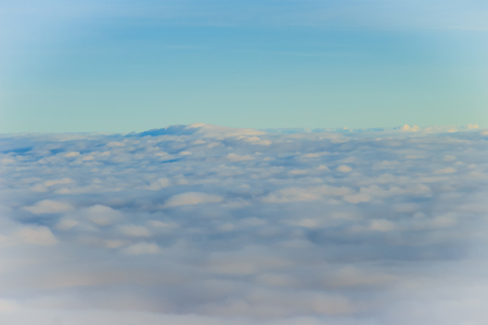 cloud drift: Beautiful cloudscape from sky aerial view. Beauty of nature view from above the sky and clouds. White clouds and blue sky view from airplane window. Sunlight in the sky shines on clouds.