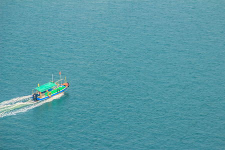 Aerial view of running boat in the sea, capture view from the Hong Kong cable car at Lantau islands,Hong Kong. Stock Photo