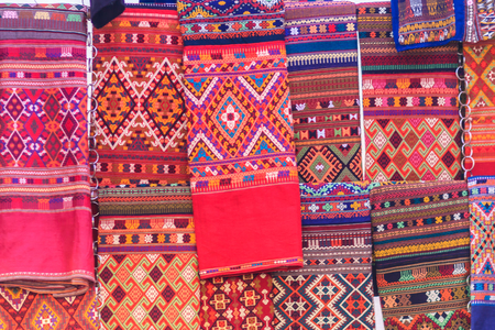 Colorful of native thai style silk and textiles pattern. Beautiful handmade woven fabrics thai silk fabric textured, with different native style patterns. Stok Fotoğraf
