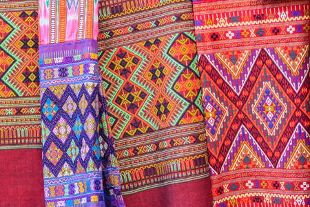 Colorful of native thai style silk and textiles pattern. Beautiful handmade woven fabrics thai silk fabric textured, with different native style patterns. 版權商用圖片
