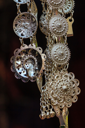 Beautiful Old antique vintage women silver belt hanging for sale in the local market at Northern Thailand.