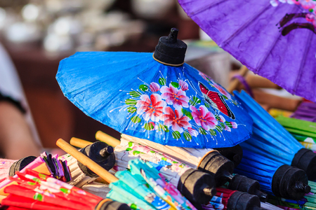 Beautiful handmade umbrellas for sale in the local market at northern Thailand. Фото со стока