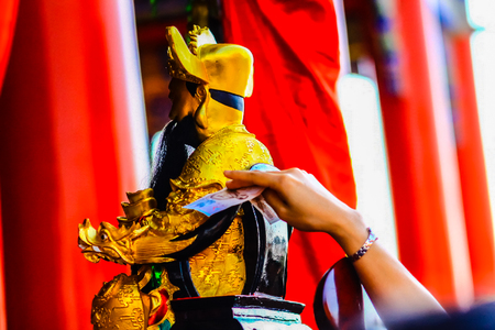 People take money bills touch with the Cai Shen, Chinese God of wealth, God of fortune image. They believed that this will be made them rich. The Chinese new year festival in Chinese temple, Thailand