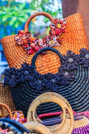 basketry: Beautiful weaved dried water hyacinth lady handbag for sale on the walking street market in Bangkok, Thailand. Stock Photo