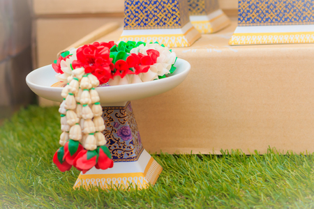 Beautiful Thais style porcelain tray with pedestal. Ideal for putting the steering sacrifice. Stock Photo