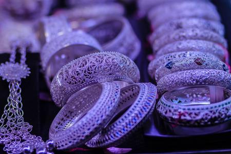 Beautiful Ancient Thai genuine silver jewelry, retro engraved silverware, Beautiful genuine silver jewelry handicrafts of Thailand Stock Photo