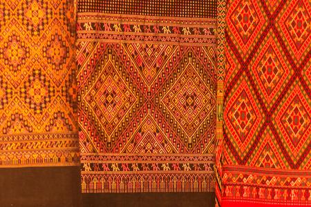 Colorful of native thai style silk. Beautiful handmade woven fabrics thai silk fabric textured Imagens