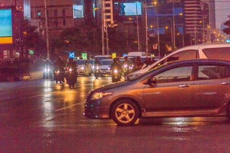 Bangkok, Thailand - January 30, 2017: Many Motorcycles on Sathorn Road in Bangkok, nearby Chong Nonsi BTS Station, in evening time. Motorists wait at a junction during rush hour in Sathorn, Bangkok. Editorial