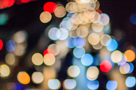 shiny car: Abstract blur bokeh of Evening traffic jam on road in city. Out of focus lights from cars in a traffic jam. Defocused lights car traffic jam of a street road at night. Road traffic jam by blur focus. Stock Photo