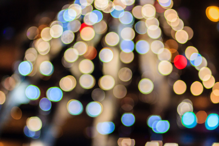 Abstract blur bokeh of Evening traffic jam on road in city. Out of focus lights from cars in a traffic jam. Defocused lights car traffic jam of a street road at night. Road traffic jam by blur focus. Stock Photo