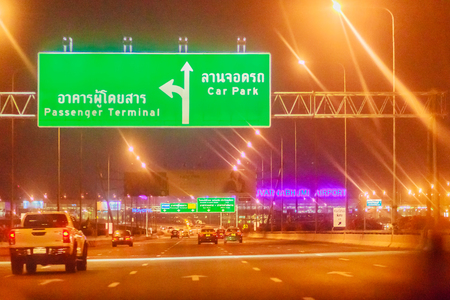 light duty: Bangkok, Thailand - February 21, 2017: Tourist is during on the way to Suvarnabhumi International Airport for morning flight at 0500 hours. Shot in taxi on late night with poor light and grain.