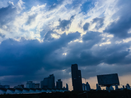 Beautiful clouds over Bangkok city.  Exotic skyline city summer colorful blue sky with cityscape urban building and cloud sunset or morning light.