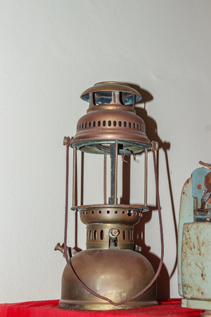 oil lamp: Antique hurricane lantern, shot with flash light. Vintage storm lantern old hurricane lantern for people who like to collect antique objects.
