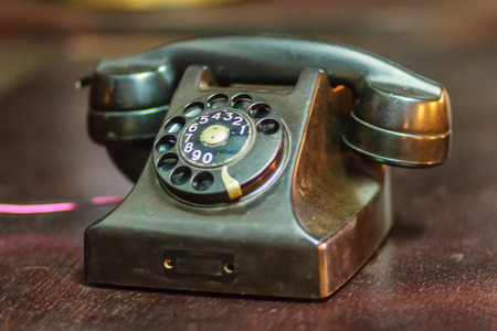 Vintage old rotary telephone. Antique rotary telephone collection. Stock Photo