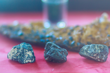 Tin ore in the rock specimen. Natural tin mineral sample for education. Stock Photo