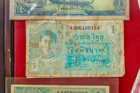 Old Thai one Baht banknotes with king Ananda Mahidol image since word war ii period for people who like to collect antique object. Vintage Thai King Ananda Mahidol banknotes collection.