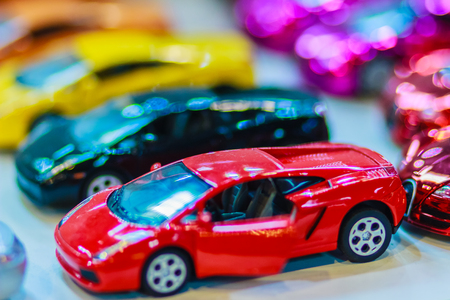 Collection of colorful little cute car. Close up cute tiny model of car, souvenir from Thailand Фото со стока