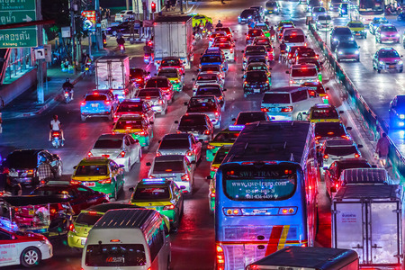 Bangkok, Thailand - February 21, 2017: View of long traffic jam at night in Asoke-Din Dang, Asoke Montri junction and New Petchaaburi Road, Waste time, lose of time, and pollution problem concept. Editorial