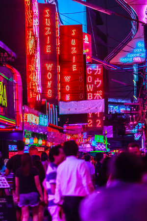 adult sex: Bangkok, Thailand - February 21, 2017: Tourist visited Soi Cowboy, internationally known as a red light district at the heart of Bangkoks sex industry. Nightlife in Soi Cowboy, Bangkok, Thailand.