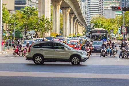 slow motion: Bangkok, Thailand - February 21, 2017: Heavily traffic jam at Thai-Japanese bridge junction nearby Sala Daeng, Silom Road and Lumpini park area in Bangkok, Thailand. Editorial