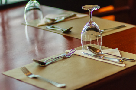 napkin ring: Glasses, spoon, frog, knife, napkin and plates on table setting for meeting and celebrating decoration.