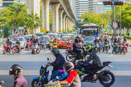 Bangkok, Thailand - February 21, 2017: Heavily traffic jam at Thai-Japanese bridge junction nearby Sala Daeng, Silom Road and Lumpini park area in Bangkok, Thailand. Editoriali