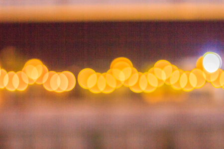 shiny car: Abstract blur bokeh of Evening traffic jam on road in city. Out of focus lights from cars in a traffic jam. Defocused lights car traffic jam of a street road at night. Road traffic jam night,blur focus Stock Photo