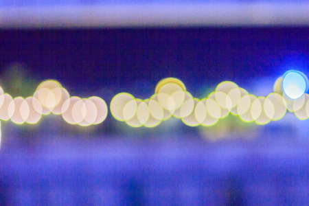 Abstract blur bokeh of Evening traffic jam on road in city. Out of focus lights from cars in a traffic jam. Defocused lights car traffic jam of a street road at night. Road traffic jam night,blur focus Stock Photo
