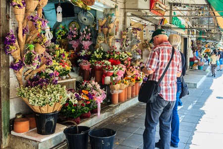 klong: Bangkok, Thailand - March 2, 2017: Flower shop selling variety of flowers at the flower market named Pak Khlong Talat in Bangkok. Pak Klong Talad is the biggest flower market in Thailand.