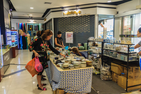 antique vase: Bangkok, Thailand - March 2, 2017: Unidentified tourist shopping for ceramic earth wares for sale in the China World shopping mall at Wangburapa, Bangkok, Thailand.