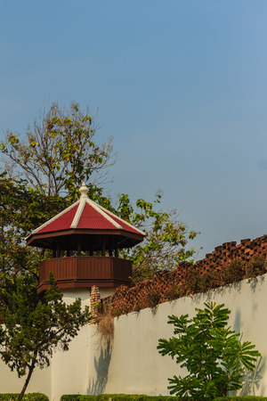 Old prison guard tower that constructed with brick, wood and red roof tiles. A watchtower on the corner of a prison wall in Bangkok, Thailand.