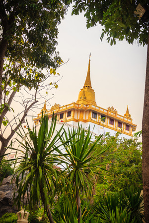 become: Beautiful view of Wat Saket Ratcha Wora Maha Wihan (Wat Phu Khao Thong, Golden Mount temple), a popular Bangkok tourist attraction and has become one of the symbols of the city.