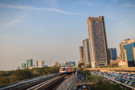Bangkok, Thailand - March 8, 2017: BTS sky train is driving to the platform at Mochit BTS station.