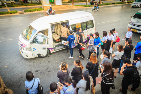 Bangkok, Thailand - March 8, 2017: Crowd of passengers are queuing for mini van, the popular public transportation that faster than bus but risk of accidents.